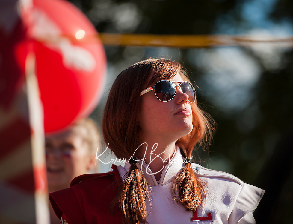 """Sophomore Jessica McDermott prepares to march with the band during the Laconia High School """"Pride"""" themed Homecoming parade Friday afternoon.   (Karen Bobotas/for the Laconia Daily Sun)"""