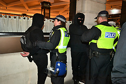 © Licensed to London News Pictures. 05/11/2017. London, UK. Demonstrators being detained by police as they take part in the Million Mask March, an anti-capitalist protest organised by Anonymous UK. The march takes place on Guy Fawkes Night, also known as bonfire night, the anniversary of the gunpowder plot to blow up the Houses of Parliament in London. Police have announced a series of restriction in an attempt to control the event. Photo credit: Ben Cawthra/LNP