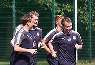 New boy Scott Allan, Paul McGowan and Scott Bain have a laugh as they warm up during pre-season testing at University Grounds, Riverside, Dundee, Photo: David Young<br /> <br />  - &copy; David Young - www.davidyoungphoto.co.uk - email: davidyoungphoto@gmail.com