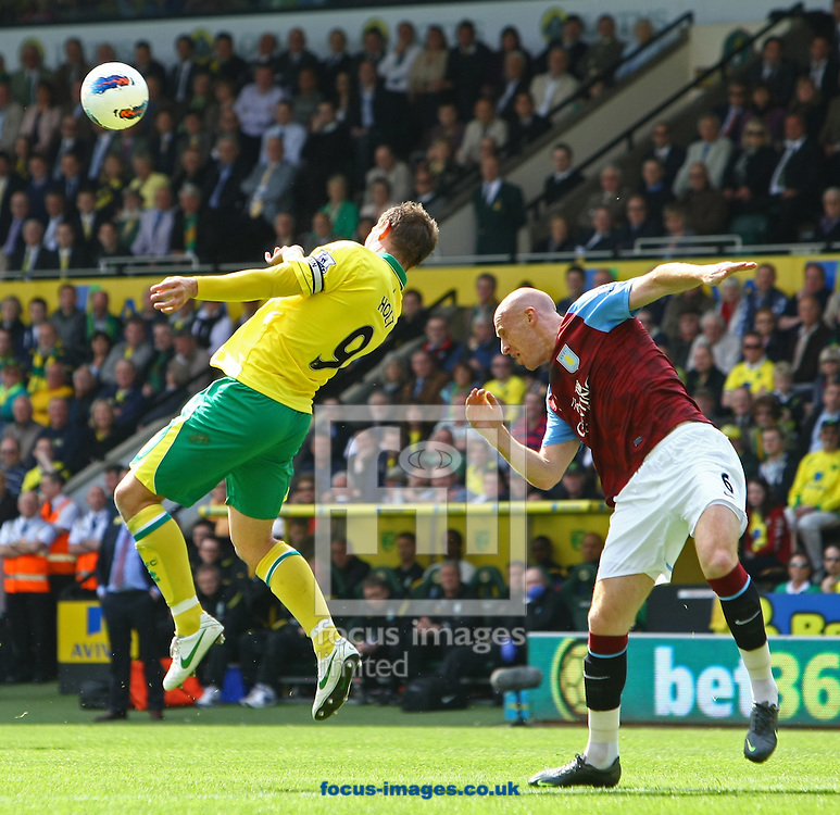 Picture by Paul Chesterton/Focus Images Ltd.  07904 640267.13/05/12.Grant Holt of Norwich and James Collins of Aston Villa in action during the Barclays Premier League match at Carrow Road Stadium, Norwich.