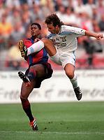 Patrick Kluivert (Barcelona) challenged by Francesco Colonnese (Lazio). Barcelona v Lazio. The Amsterdam Tournament. Amsterdam Arena, 5/8/2000. Credit: Colorsport / Stuart MacFarlane.