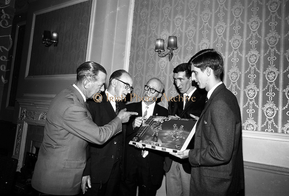 21/05/1966<br /> 05/21/1966<br /> 21 May 1966<br /> Castrol (Ireland) Ltd. presentation of Castrol Trophy to Home Farm football team at the Central Hotel, Dublin. Replicas were presented to each of the players and Drumcondra, who were runners-up received medals. Picture shows (l-r): Mr. Leonard A. Courtney, Managing Director of Castrol (Ireland) Ltd.; Mr. R.J. Doram, Honorary Treasurer, F.A.I.; P. McGrath, Captain Drumcondra team and Jerry James, Captain of Home Farm admiring the trophy.