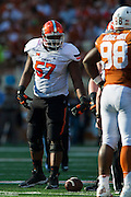 AUSTIN, TX - SEPTEMBER 26:  Paul Lewis #57 of the Oklahoma State Cowboys lines up against the Texas Longhorns on September 26, 2015 at Darrell K Royal-Texas Memorial Stadium in Austin, Texas.  (Photo by Cooper Neill/Getty Images) *** Local Caption *** Paul Lewis