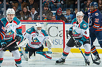 KELOWNA, CANADA - DECEMBER 27: James Porter #1 defends the net as Gordie Ballhorn #4 of the Kelowna Rockets is back checked by Jermaine Loewen #32 of the Kamloops Blazers on December 27, 2017 at Prospera Place in Kelowna, British Columbia, Canada.  (Photo by Marissa Baecker/Shoot the Breeze)  *** Local Caption ***