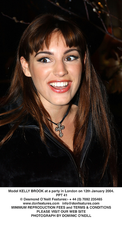 Model KELLY BROOK at a party in London on 12th January 2004.PPT 41