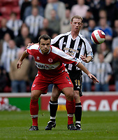 Photo: Jed Wee.<br /> Middlesbrough v Newcastle United. The Barclays Premiership. 22/10/2006.<br /> <br /> Middlesbrough's Mark Viduka (L) holds off Newcastle's Craig Moore.