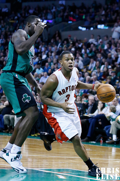 13 March 2013: Toronto Raptors point guard Kyle Lowry (3) drives past Boston Celtics power forward Brandon Bass (30) during the Boston Celtics 112-88 victory over the Toronto Raptors at the TD Garden, Boston, Massachusetts, USA.