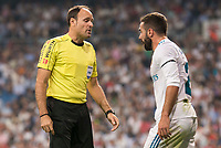 Real Madrid's Daniel Carvajal talking with referee Mateu Lahoz during La Liga match between Real Madrid and Real Betis at Santiago Bernabeu Stadium in Madrid, Spain September 20, 2017. (ALTERPHOTOS/Borja B.Hojas)