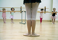 From left, Ava Ferry, 3, Lua Songer-Johnson, 4, Stephanie Bonilla, 3, and Mattie Keller, 4, all of Reston, Va., line up at the barre in the pre-ballet class at the Reston Community Center. (photo by Barbara L. Salisbury/The Washington Times)