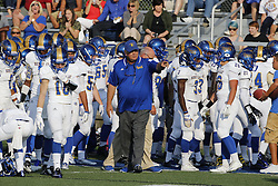 Henry Clay head coach Sam Simpson directs his team before kickoff against St. Xavier at Lexington Catholic High School, Friday, Aug. 28, 2015 in Lexington.