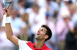 Serbia's Novak Djokovic celebrates his win against Australia's John Millman during day two of the Fever-Tree Championship at the Queens Club, London.
