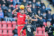 Leyton Orient forward Ollie Palmer  and York City defender George Swann battle in the air during the Sky Bet League 2 match between Leyton Orient and York City at the Matchroom Stadium, London, England on 21 November 2015. Photo by Simon Davies.