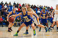 Lamoille's Brooke Naylor (12) saves the ball from going out of bounds during the girls basketball game between Lamoille and Milton at Milton High School on Friday night December 18, 2015 in Milton, (BRIAN JENKINS/for the FREE PRESS)