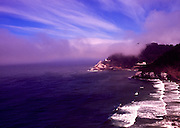 Image of Heceta Head Lighthouse on cliff at dusk overlooking the Pacific Ocean, near Florence, Oregon, Pacific Northwest