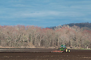 Goshen, New York - A farmer works fields with a tractor in the Black Dirt region on April 26, 2015.