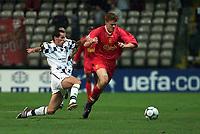 Football: Liverpool's John Arne Riise and Boavista's Turra Paulo.