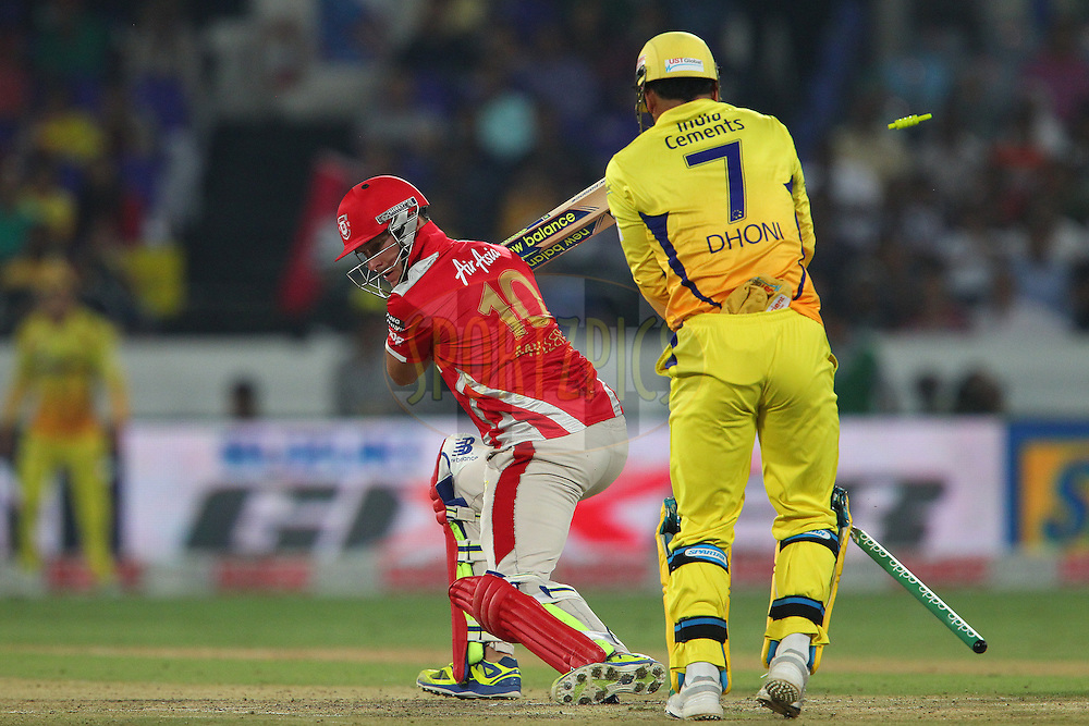 David MILLER of the Kings XI Punjab looks back as his stumps break during the second semi final match of the Oppo Champions League Twenty20 between the Kings XI Punjab and the Chennai Superkings held at the Rajiv Gandhi Cricket Stadium, Hyderabad, India on the 2nd October 2014<br /> <br /> Photo by:  Ron Gaunt / Sportzpics/ CLT20<br /> <br /> <br /> Image use is subject to the terms and conditions as laid out by the BCCI/ CLT20.  The terms and conditions can be downloaded here:<br /> <br /> http://sportzpics.photoshelter.com/gallery/CLT20-Image-Terms-and-Conditions-2014/G0000IfNJn535VPU/C0000QhhKadWcjYs