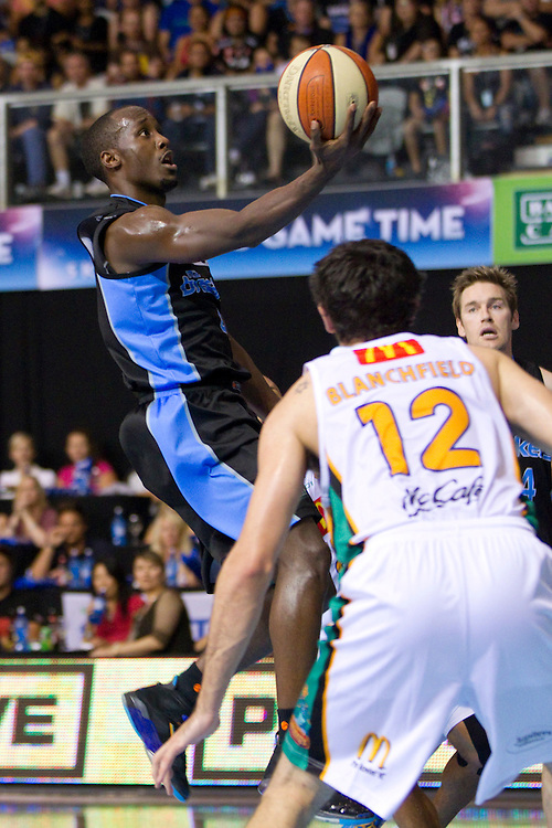 Breakers' Cedric Jackson jumps above Crocodiles' Todd Blanchfield to score in an ANBL Basketball Match, North Shore Events Centre, Auckland, New Zealand, Thursday, February 23, 2012.  Credit:SNPA / David Rowland
