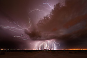 """The Storm Chaser<br /> <br /> Mike Olbinski went from photographing lightning in his backyard with a point-and-shoot camera to being a professional storm photographer—in a flash. His time-lapse storm videos have gone viral in a big way; one of them even made an appearance in a major motion picture. we spoke to Olbinski to find out how he does it.<br /> <br /> <br /> Was storm photography how you started getting into photography?<br /> I've always been a weather nut, and I would always write on Facebook that I should be a meteorologist, and why didn't I go to school for that, and all that kind of stuff. So I always liked that, and I just started looking at photography, and started following some guys who were doing lightning photography, and thought, """"that looks like so much fun."""" So I took this little camera out, and would just hold the shutter down, and it would just go click, click, click, and I would try to take pictures of lightning, and I got a few that were ok, and then one night I got an amazing one, and I couldn't believe it. Then I got on the local news, and I was hooked from there. I told my wife, """"I've got to get a camera that can do long exposures,"""" so we sold all of our DVDs on eBay for almost $500, and I bought a Canon Rebel and just started from there.<br /> <br /> <br /> Do you remember the first storm photo that you sold?<br /> Once I started getting into time lapses, that was when everything really took off for me, because selling prints is really hard, unless you're a name, and getting yourself a name takes time. People started licensing footage for stuff, and that's when I started making money. The latest big thing for me was this supercell I shot last June, in Texas, and it was just kind of rotating dust, and lots of colors, and that went viral. I didn't think that would happen to me again after my dust storm video in 2011, which went viral; that was a once-in-a-lifetime thing. But this was even bigger, and was actually the #1 time-lapse video o"""