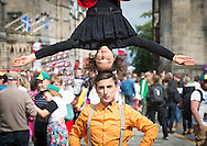 Edinburgh Festival Fringe madness on the mile Day 1. 1st August 2014.<br /> <br /> PSS PSS - Baccala Clown - Camilla Pessi and Simone Fassari<br /> edfringe, street theatre, royal mile, high street<br /> <br /> Photograph by Alex Hewitt<br /> alex.hewitt@gmail.com<br /> 07789 871540