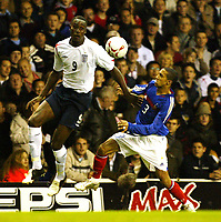 Photo: Chris Ratcliffe.<br /> England v France. U21 European Championships.<br /> 11/11/2005.<br /> CArlton Cole and Gael Clichy tussle for the ball