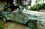"Ubud. Artist Suliyat Buamar in his rolling piece of art ""Crazy Boy"" (1998, oil on a vintage Volkswagen jeep)"