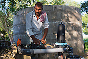 Vishram turns on the pump of his new drip irrigation system which only takes a matter of minutes to water his crops instead of several days, which is what it used to take when he was using flood irrigation.<br /> <br /> Not only are Vishram and his wife saving lots of time, not having to direct the flood waters, but they are seeing less weeds and so there is little weeding to be done.<br /> <br /> Drip irrigation also means they are using a lot less water, because the water is fed directly to the base of each plant, via a small drip, instead of flooding an entire field. <br /> <br /> All this not only dramatically decreases their risk of running out of water, but it is allowing them to do other things with their time and water, like grow vegetables and Vishram has even started contracting as a tracter driver on other farms.