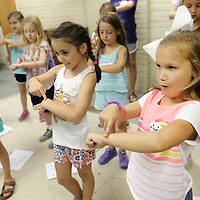 Charli Stennett, 7, of Guntown, goes through her dance moves at TCT Camp on Tuesday in Tupelo, as she follows the instruction of her teacher Claire Leeke.