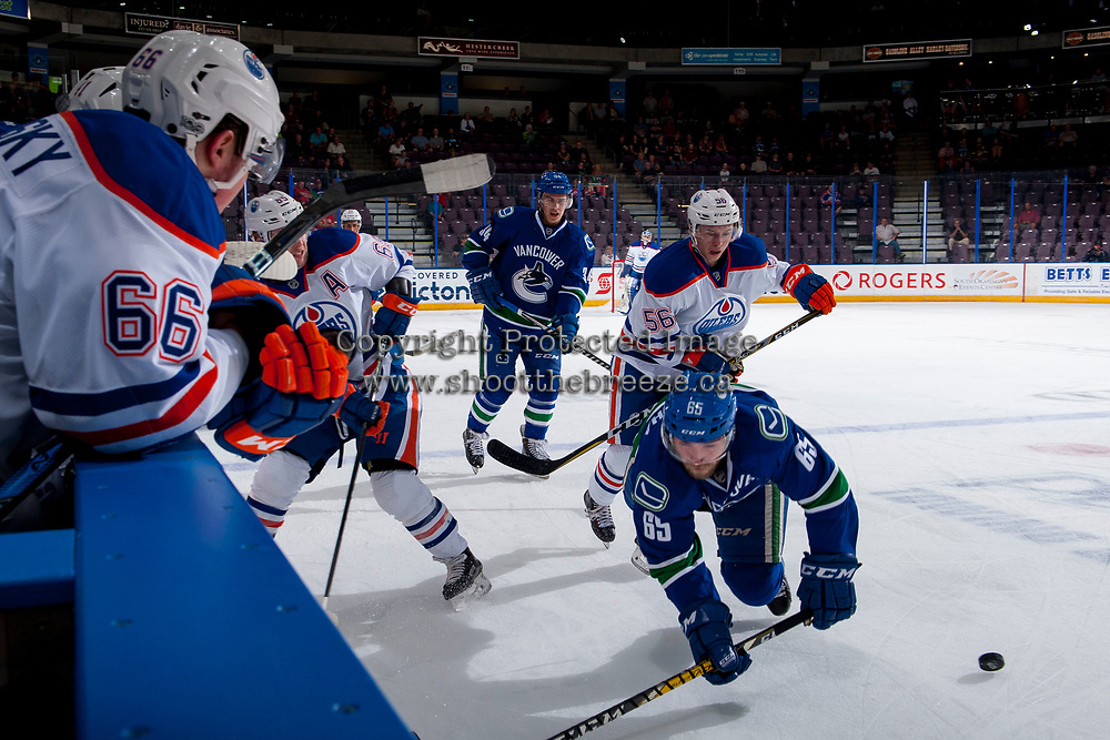 PENTICTON, CANADA - SEPTEMBER 11: Kailer Yamamoto #56 of Edmonton Oilers checks Aaron Berisha #65 of the Edmonton Oilers on September 11, 2017 at the South Okanagan Event Centre in Penticton, British Columbia, Canada.  (Photo by Marissa Baecker/Shoot the Breeze)  *** Local Caption ***