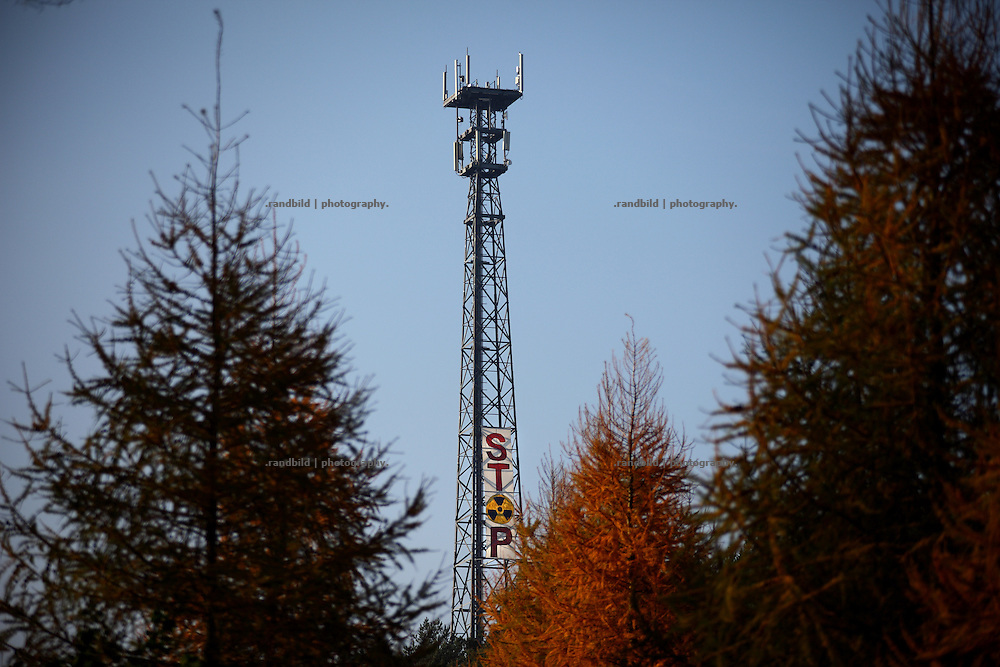 Prior to an expected transport of nuclear waste to Gorleben a protest banner hangs down from a cellphone tower near Dannenberg.