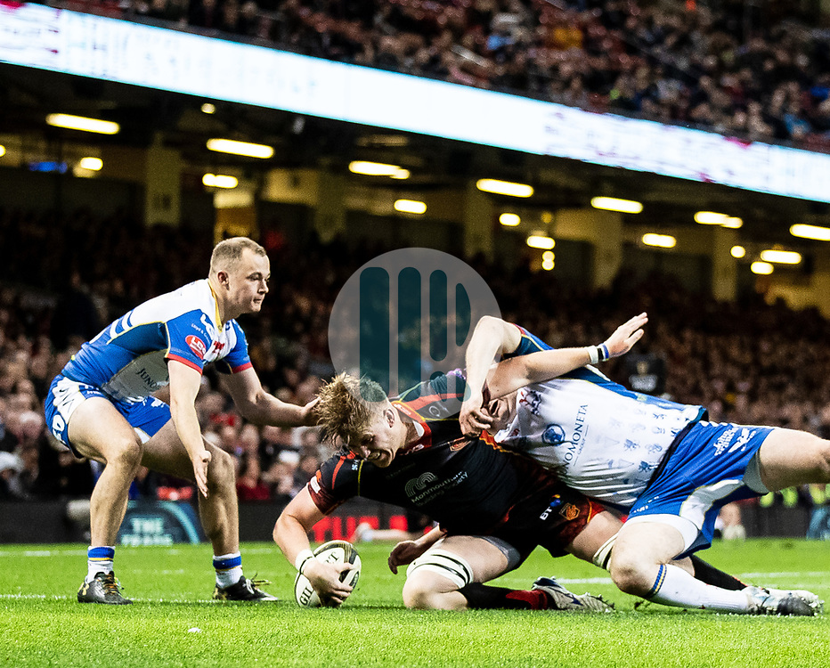 Matthew Screech of Dragons scores his sides first try<br /> <br /> Photographer Simon King/Replay Images<br /> <br /> Guinness PRO14 Round 21 - Dragons v Scarlets - Saturday 27th April 2019 - Principality Stadium - Cardiff<br /> <br /> World Copyright © Replay Images . All rights reserved. info@replayimages.co.uk - http://replayimages.co.uk