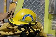 © 2008 Randy Vanderveen, all rights reserved.Grande Prairie, Alberta.A fire helmet sits on the back of a pumper as Grande Prairie firefighters train in Muskoseepi Park by conducting some Performance Standard Drills during the mid-day hours of a summer day.