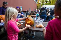Boys and Girls Club pumpkin carving for Pumpkin Fest 2015.  Karen Bobotas for the Laconia Daily Sun