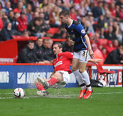 Charlton Athletic's Yann Kermorgant tackles a Doncaster Rovers' James Husband  - Photo mandatory by-line: Robin White/JMP - Tel: Mobile: 07966 386802 24/08/2013 - SPORT - FOOTBALL - The Valley - Charlton -  Charlton Athletic V Doncaster Rovers - Sky Bet League Two