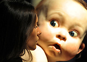 © licensed to London News Pictures. LONDON, UK.  13/06/11. A gallery assistant looks at 'Big Baby' by artist Ron Mueck. It is being offered for sale by the collector Kay Saatchi and is expected to fetch £800,000-1,200,000 at auction. Photo call at Christie's, London, for the unveiling of rarely seen masterpieces by Picasso, Michelangelo and Gainsborough before they are offered for sale. Photo credit should read Stephen Simpson/LNP
