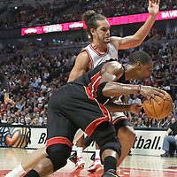 14 March 2012: Miami Heat power forward Chris Bosh (1) drives past Chicago Bulls center Joakim Noah (13) during the Chicago Bulls 106-102 victory over the Miami Heat at the United Center, Chicago, Illinois, USA.