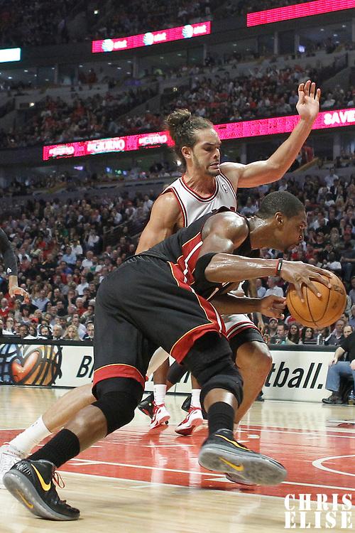 14 March 2012: Miami Heat power forward Chris Bosh (1) drives past Chicago Bulls center Joakim Noah (13) during the Chicago Bulls 106-102 victory over the Miami Heat at the United Center, Chicago, Illinois, USA.