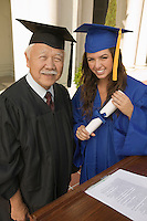 Graduate with Diploma next to Administrator