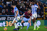 Marko Arnautovic of West Ham United (7) feels he is fouled by. Terence Kongolo of Huddersfield Town (5) as Christopher Schindler of Huddersfield Town (26) sweeps up the loose ball during the Premier League match between Huddersfield Town and West Ham United at the John Smiths Stadium, Huddersfield, England on 10 November 2018.