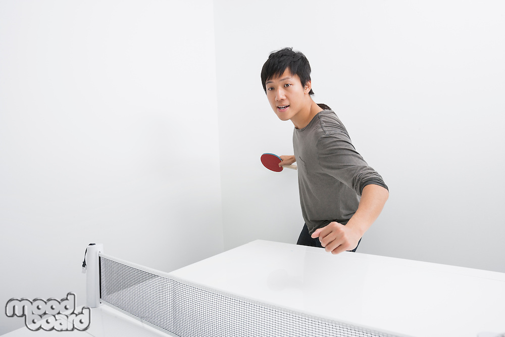 Portrait of man playing table tennis
