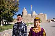 Uzbekistan, Bukhara. Ismail Samani Mausoleum, Samanids recreation park. Uzbek couple.