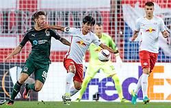 15.09.2016, Red Bull Arena, Salzburg, AUT, UEFA EL, FC Red Bull Salzburg vs FC Krasnodar, Gruppe I, 1. Runde, im Bild Fedor Smolov (FC Krasnodar), Takumi Minamino (FC Red Bull Salzburg) // during the UEFA Europa League, group I, 1st round match between FC Red Bull Salzburg and FC Krasnodar at the Red Bull Arena in Salzburg, Austria on 2016/09/15. EXPA Pictures © 2016, PhotoCredit: EXPA/ JFK