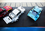 Image of a Porsche 934.5 and 935 on the grid at the 2017 Monterey Historics Reunion, Laguna Seca Raceway, Monterey, California, America west coast