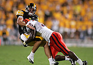 08 SEPTEMBER 2007: Iowa quarterback Ricky Stanzi (12) is hit by Syracuse defensive lineman Oliver Haney (92) after his throw in Iowa's 35-0 win over Syracuse at Kinnick Stadium in Iowa City, Iowa on September 8, 2007.