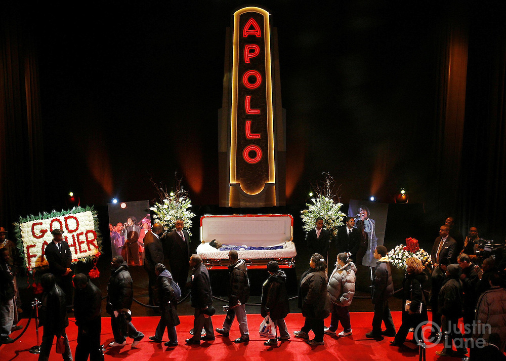 People pay their respects to the late James Brown (C) as he lies in repose on the stage of the Apollo Theater in Harlem, New York on Thursday 28 December 2006. Music legend Brown, who died at the age of 73 earlier this week, is being honored with ceremonies in New York and Georgia over the next few days...