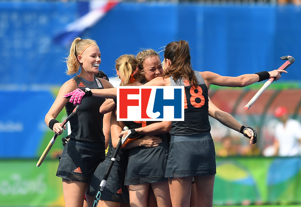 Netherland's players celebrate a goal during the women's field hockey Netherlands vs Spain match of the Rio 2016 Olympics Games at the Olympic Hockey Centre in Rio de Janeiro on August, 7 2016. / AFP / MANAN VATSYAYANA        (Photo credit should read MANAN VATSYAYANA/AFP/Getty Images)