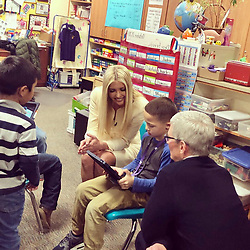 """Ivanka Trump releases a photo on Twitter with the following caption: """"""""Great being with @Tim_Cook in Wilder, ID today and meeting so many exemplary students, teachers and administrators. @Apple's public-private partnership illustrates the power + potential of #Tech to revolutionize education and prepare America's students for success!"""""""". Photo Credit: Twitter *** No USA Distribution *** For Editorial Use Only *** Not to be Published in Books or Photo Books ***  Please note: Fees charged by the agency are for the agency's services only, and do not, nor are they intended to, convey to the user any ownership of Copyright or License in the material. The agency does not claim any ownership including but not limited to Copyright or License in the attached material. By publishing this material you expressly agree to indemnify and to hold the agency and its directors, shareholders and employees harmless from any loss, claims, damages, demands, expenses (including legal fees), or any causes of action or allegation against the agency arising out of or connected in any way with publication of the material."""