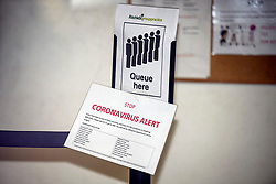 """© Licensed to London News Pictures. 13/02/2020. London, UK. A """"CORONAVIRUS ALERT"""" sign next to a queueing area inside Ritchie Street Health Centre in Islington which has closed due to the Coronavirus COVID-19 outbreak, according to a notice on its website. Photo credit: Ben Cawthra/LNP"""