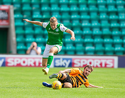 Hibernian's Fraser Murray and Alloa Athletic's Steven Hetherington. Hibernian 2 v 0 Alloa Athletic, Betfred Cup game played Saturday 20th July at Easter Road, Edinburgh.