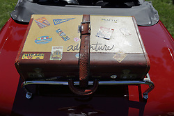2018 Champagne British Car Festival held on Clover Lawn at David Davis Mansion in Bloomington IL<br /> <br /> Suitcase with city stickers strapped to luggage rack on trunk (boot).